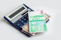 欧洲金钱和美元在捆绑在计算器说谎 库存图片