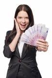 给欧洲金钱的激动的妇女 免版税图库摄影