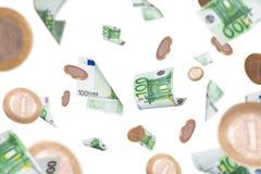 欧洲钞票和硬币飞行 库存图片