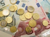 欧洲钞票和硬币 图库摄影