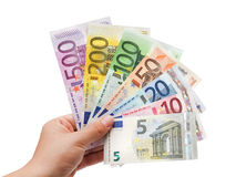 欧洲钞票在手中在white 免版税库存照片