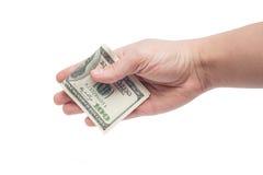 给贿款100 USD的手 免版税库存图片