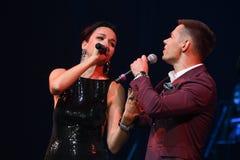 歌手斯拉娃L和Stas Piekha R在阶段执行在维克托Drobysh第50个年生日音乐会期间在巴克来中心 图库摄影
