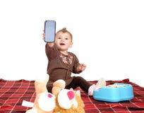 阻止手机的婴孩 免版税库存照片