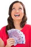 阻止散开的钞票的一个少妇的演播室射击 免版税库存图片