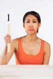 阻止计分卡的哀伤的妇女给标记从十当中 库存图片