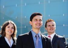 正式衣裳的三个新企业人员 免版税图库摄影