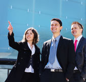 正式衣裳的三个新企业人员 免版税库存照片