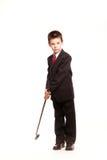 正式dresscode的男孩与高尔夫俱乐部 库存图片