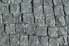 正方形标示用鹅卵石或石头路面、走道或者路 图库摄影
