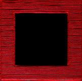 正方形被构筑的正文框红色黑背景 免版税库存照片