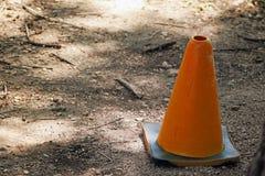正离子沿着走的锥体警告这条道路 免版税库存图片