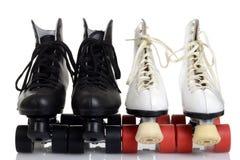 正面图男人和妇女用空铅填溜冰鞋 库存图片