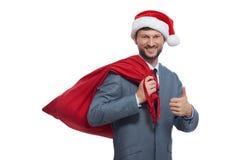 正面圣诞老人显示超级由手指和微笑 图库摄影