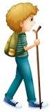 步行与木头的男孩 免版税库存照片