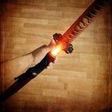 武士在火的katana剑 库存照片