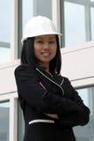 武装亚裔工程师女性被折叠 免版税库存照片