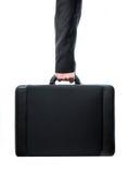 武装的手藏品手提箱 免版税库存图片