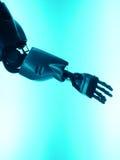 武装的手让机器人s震动 库存图片