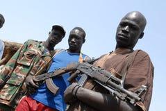 武装的青年 免版税库存照片