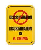 歧视是罪行黄色标志 库存照片