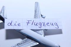 死Flugzeug词用飞机的德语用英语 图库摄影