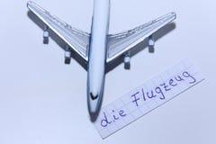 死Flugzeug词用飞机的德语用英语 免版税图库摄影