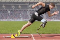 残疾短跑选手起动块 免版税库存照片
