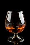 残破的玻璃威士忌酒 免版税图库摄影