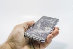 残破的玻璃手机 免版税库存照片