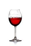 残破的玻璃红葡萄酒 图库摄影