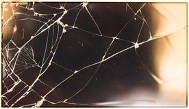 残破的玻璃葡萄酒背景 库存图片