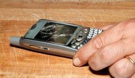 残破的移动电话smartphone 免版税库存照片