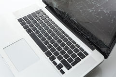 残破的膝上型计算机 免版税图库摄影