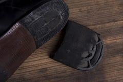 残破的鞋子 免版税库存图片