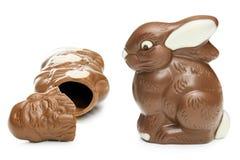 残破的巧克力圣诞老人和复活节兔子 免版税库存图片