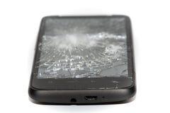 残破的智能手机关闭,被打碎的屏幕 免版税图库摄影
