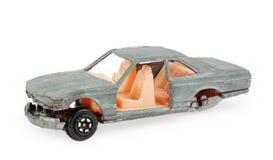 残破的灰色儿童的玩具汽车模型 库存图片