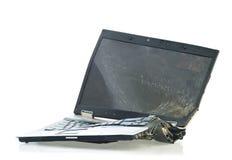 残破的计算机膝上型计算机 库存照片