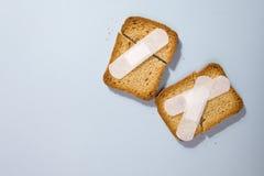 残破的面包干和医疗膏药 库存图片
