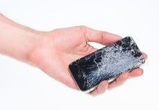 残破的Apple iPhone 4在手中 免版税图库摄影