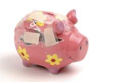 残破的piggybank 免版税库存图片