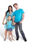 母亲、父亲和小的女儿立场 免版税库存图片