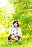 母亲和儿子春天画象在母亲节 图库摄影
