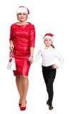 母亲和女儿圣诞老人帽子的 库存图片