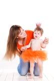 母亲和女儿在公主服装穿戴了 免版税库存图片