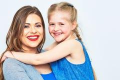 母亲和女儿容忍 微笑 免版税库存照片