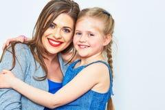 母亲和女儿容忍 微笑 库存照片