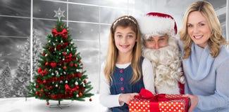 母亲和女儿的综合图象有圣诞老人的 库存照片
