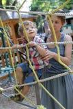 母亲帮助她的儿子 图库摄影